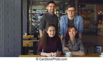 Portrait of two couples happy young people friends in casual...