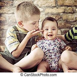Portrait of two cute children