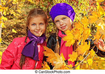 sisters - Portrait of two cute girls sisters in the leaves...