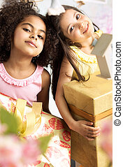 Portrait of two cute girls with the gifts
