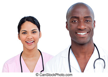 Portrait of two enthusiastic doctors against a white...