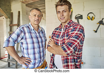 Portrait of two generation of carpenters