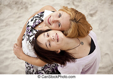 Portrait of two girls on the beach.