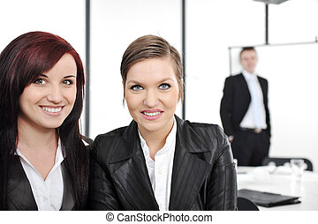 Portrait of two happy businesswomen in business presentation at office