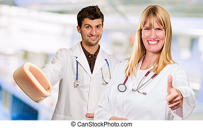 Portrait Of Two Happy Doctors