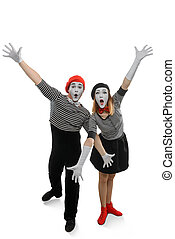 Portrait of two happy mimes posing with arms wide open