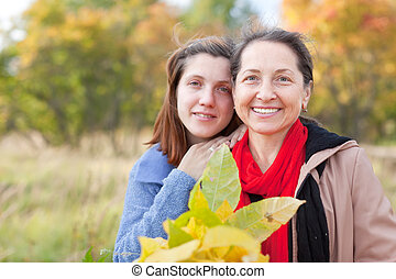 women in autumn  garden
