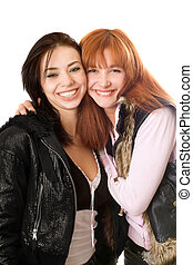 Portrait of two happy young women. Isolated