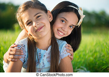 Portrait of two hispanic teen girls