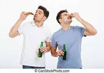 Portrait of two hungry young men celebrating