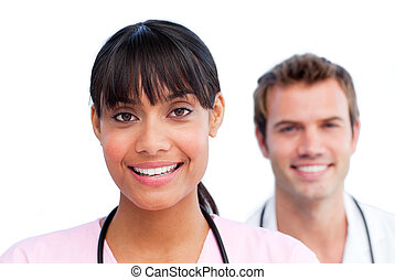 Portrait of two jolly doctors against a white background