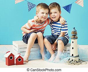 Portrait of two little sailors