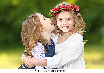 portrait of two little sisters with berries