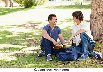 Portrait of two male students talking