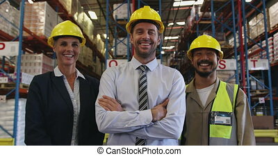 Portrait of two managers and a warehouse worker 4k