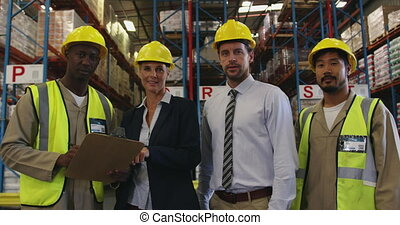 Portrait of two managers and two warehouse workers 4k - ...
