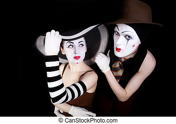 Portrait of two mimes in white gloves