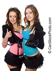 Portrait of two playful attractive young women. Isolated