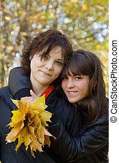 girls in autumn park