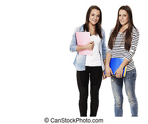 portrait of two pretty student teenagers with note pads on white background