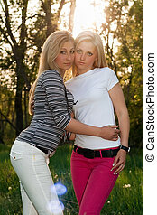 Portrait of two pretty young blonde