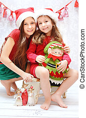 Portrait of two santa sisters