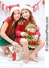 Portrait of two santa sisters