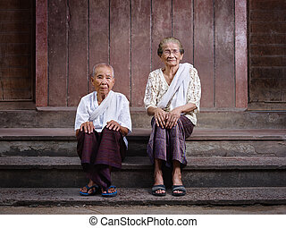 Portrait of two senior asian women looking at camera