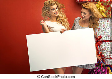 Portrait of two sexy girl with board