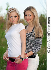 Portrait of two smiling attractive young women