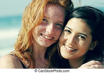 portrait of two smiling girlfriends