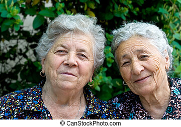 Portrait of two smiling old ladies