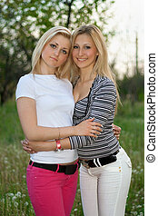 Portrait of two smiling pretty young women
