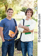 Portrait of two standing handsome students talking