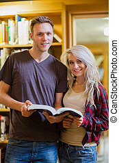 Portrait of two students reading b