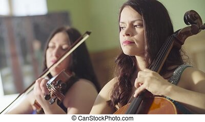 Portrait of two women playing music