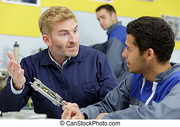 portrait of two workers are talking