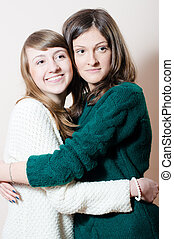 portrait of two young attractive adorable women friendly...