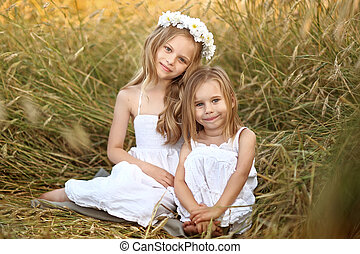 Portrait of two young girlfriends with flowers