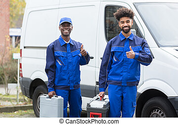 Portrait Of Two Young Manual Worker With Their Tool Boxes