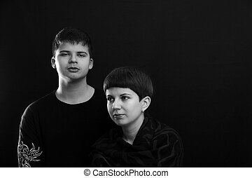 Portrait of two young peoples. Black and white picture.