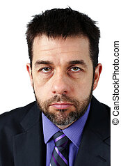 Portrait of unhappy man in suit