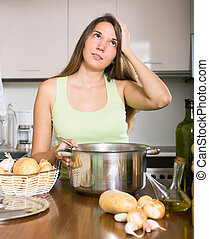 unhappy woman at home kitchen