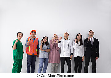 Portrait of various professions pointing up