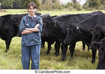 Portrait Of Vet In Field With Cattle