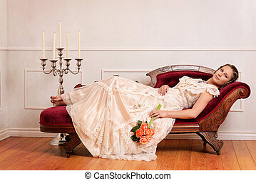 victorian woman on couch with orange roses