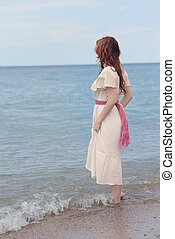 vintage woman wadding in the sea - portrait of vintage woman...