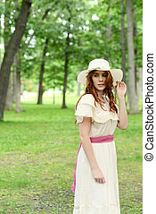 vintage woman wearing a hat in park setting