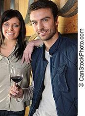 Portrait of vintners in cellar