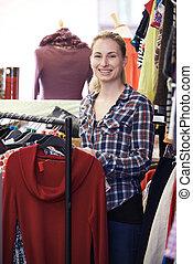 Portrait Of Volunteer Working In Charity Shop